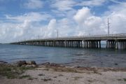 Photo: Buttonwood: Gravel, rip rap, water and new Bahia Honda Bridge in the background.