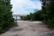 Photo: Buttonwood: Gravel site, water and new Bahia Honda Bridge in the background.