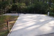 ADA-accessible campsite with concrete pad.