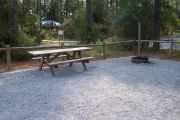 A view of the picnic table and grill.