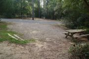Campsite with picnic table facing neighboring campsite.