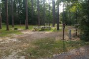 Pull through campsite with water, electric and two picnic tables.