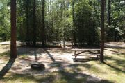 Pull through campsite with water, electric and picnic table.