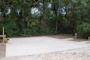 This site is equipped with a large ADA concrete pad for easy access for hook up and pull in.