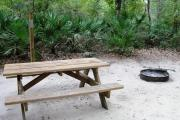 This view shows an up close view of the picnic table on the campsite.