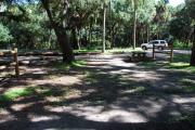 This is a picture of campsite 25 from the back of the site looking toward the road.   The site has water and 50amp electric service.  This is a shady tent only site with a gravel foundation.  The site has a picnic table and a ground campfire ring.