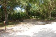 Campsite 43 is a partial sunny site with a gravel foundation located on the right hand side of the road.  Looking into the site on the right is the water and 50amp electrical service. There is a picnic table and ground campfire ring.  At the front left side of the site is the brown site marker.