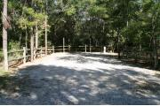 32 foot back in site surrounded by beautiful trees and split rail fencing.