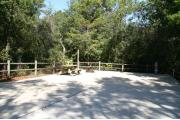 30 foot back in site surrounded by beautiful trees and split rail fencing with concrete pad.