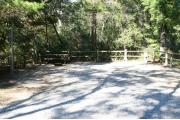 30 foot back in site surrounded by beautiful trees and split rail fencing.