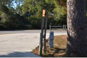 Sign post seventeen is located to the right. Sign post connect to another post with a clothes line tied between them. Electrical post and water spigot are located to the right of the post.