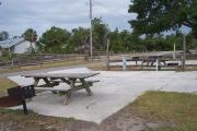 This ADA accessible site is paved with concrete and has an accessible grill and picnic table.