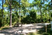 View from the right showing picnic table and ground grill.