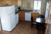 Kitchen with stove, refrigerator, dishwasher