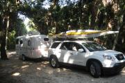 Campers are working to set up their site for the weekend in the campground at Tomoka State Park. They came prepared with a small travel trailer and two kayaks for exploring the rivers and creeks which are accessible from the boat ramp in Tomoka State Park.
