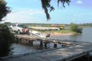 A fisherman launches his boat at the marina at Tomoka State Park, with rental canoe and kayaks in the background, set on the scenic Tomoka River. Campers are welcome to bring their boats, or rent them from the Tomoka Outpost in order to fully experience the rivers, which provide great fishing, recreation, and wildlife viewing opportunities.