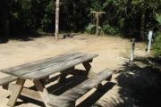 Each site is equipped with a picnic table, lantern post, hose bib, electric hook-up for 20 and 50 amp service, and fire pit on the ground with a fold over grill top.