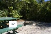 Campsite #32 at Blue Spring State Park showing picnic table and fire ring.