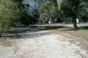 This 67 foot pull through site has a wooden picnic table and a fire ring/grill. It also has electrical and water spigot connections. Site number 15 is directly across the road of our parks newest playground.