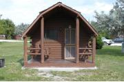 Photo: 002, PRIM. Cabin #2 at Oleta River has a porch swing and a barbeque grill.