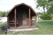 Photo: 004, PRIM. Cabin #4 at Oleta River has a porch swing and a barbeque grill.