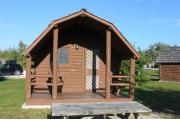 Photo: 006, PRIM. Cabin #6 at Oleta River has a porch swing and a picnic table.