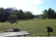 Photo: 006, PRIM. Cabin #6 at Oleta River has a fire ring, a barbeque grill and a picnic table.