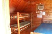 Photo: 007, PRIM. Cabin #7 at Oleta River has a set of bunk beds and a double bed.