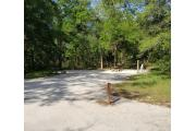 32a-Site 32 is a spacious back-in site with picnic table, fire ring, stand up barbecue grill, and electric/water hook up.