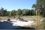 This site has a standing grill, fire ring, picnic table, water, electric 20/30/50 amp, and sewer. Amenities include a camp store, recreation hall, ADA accessible showers and restrooms, laundry, dump station, canoe rentals, short walk to the river, and playground. Tents and RV (maximum length of 40 ft) are allowed. This site is fine gravel surface.