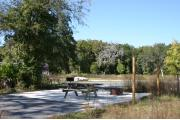 This site has a standing grill, fire ring, picnic table, water, electric 20/30/50 amp, and sewer. Amenities include a campground store, recreation hall, ADA accessible showers and restrooms, laundry, dump station, canoe rentals, short walk to the river, and playground. Maximum RV length is 40 ft. This is a paved ADA accessible site.