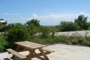 Photo: 020, View looking out from back of site to beach, Atlantic Ocean and bushes in background.