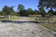 Photo: 14, Loop B. View of campsite with electric hookup and picnic table.