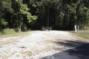Photo: 001, SANTOS CAMPGROUND. View of campsite with water and electric hookups and picnic table with fire ring.