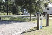 Photo: 002, SANTOS CAMPGROUND. View of campsite with water and electric hookups and picnic table with fire ring.