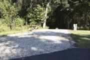 Photo: 003, SANTOS CAMPGROUND. View of campsite with water and electric hookups and picnic table with fire ring.