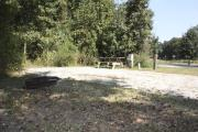Photo: 005, SANTOS CAMPGROUND. View of campsite with water and electric hookups and picnic table with fire ring.