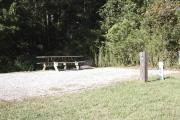 Photo: 008, SANTOS CAMPGROUND. View of campsite with water and electric hookups and picnic table with fire ring.