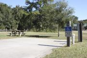 Photo: 009, SANTOS CAMPGROUND. ADA accessible site with concrete pad, electric and water hookups and picnic table.