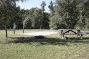 Photo: 009, SANTOS CAMPGROUND. View of ADA accessible site with concrete pad and picnic table.