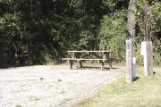 Photo: 010, SANTOS CAMPGROUND. View of campsite with water and electric hookups and picnic table with fire ring.
