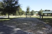 Photo: 013, SANTOS CAMPGROUND. View of campsite with water and electric hookups and picnic table with fire ring.