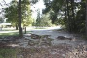Photo: 014, SANTOS CAMPGROUND. View of campsite with water and electric hookups and picnic table with fire ring.