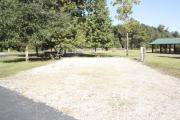 Photo: 015, SANTOS CAMPGROUND. View of campsite with water and electric hookups and picnic table with fire ring.