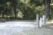 Photo: 016, SANTOS CAMPGROUND. View of campsite with water and electric hookups and picnic table with fire ring.