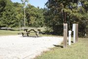 Photo: 017, SANTOS CAMPGROUND. View of campsite with water and electric hookups and picnic table with fire ring.