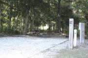 Photo: 018, SANTOS CAMPGROUND. View of campsite with water and electric hookups and picnic table with fire ring.