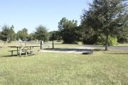 Photo: 019, SANTOS CAMPGROUND. View of campsite with water and electric hookups and picnic table with fire ring.