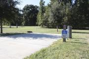 Photo: 020, SANTOS CAMPGROUND. ADA accessible site with concrete pad, electric and water hookups and fire ring.