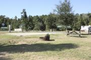Photo: 023, SANTOS CAMPGROUND. View of campsite with water and electric hookups and picnic table with fire ring.